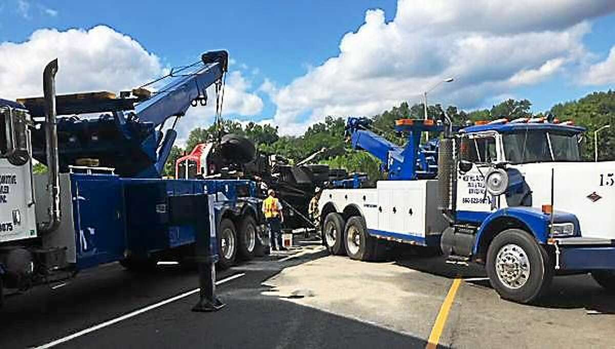 Crews work Thursday to remove the crane from I-84 east.