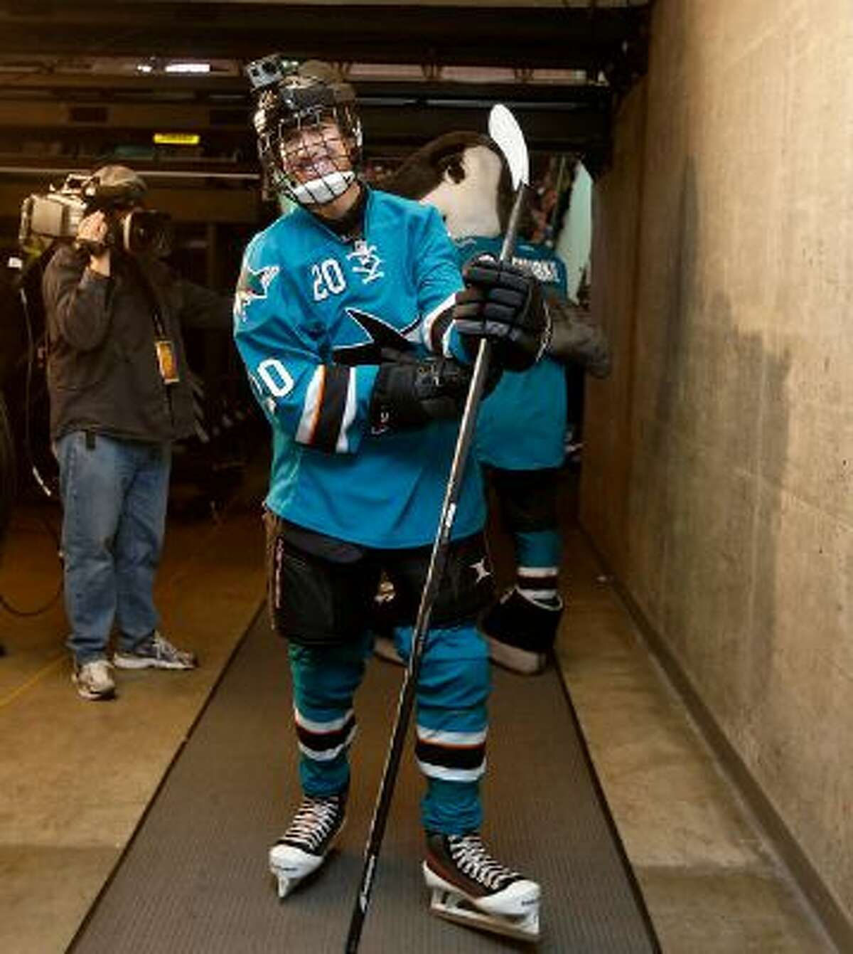 Sam Tageson, 18-year-old youth hockey player from Martinez with a life-threatening heart condition is getting a taste of life in the NHL through the Make-A-Wish Foundation and the Sharks Foundation. Tageson skated out to ice with the San Jose Sharks during opening ceremony at SAP Center in San Jose, Calif. on Tuesday, March 18, 2014. (Josie Lepe/Bay Area News Group)