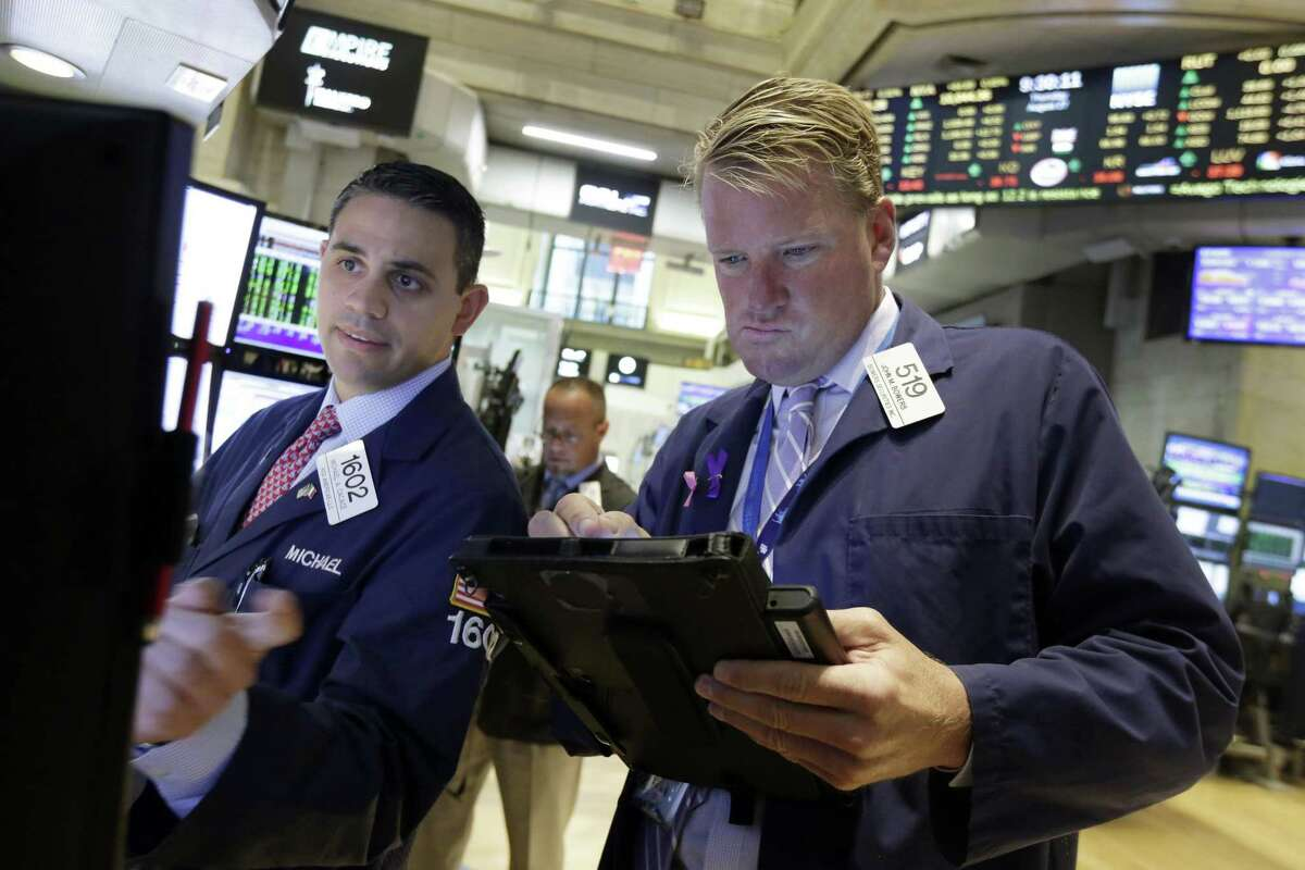 Specialist Michael Cacacae, left, works with trader John Bowers on the floor of the New York Stock Exchange, Thursday, Aug. 27, 2015. U.S. stocks are opening higher after China's main stock index logged its biggest gain in eight weeks. A report also showed that the U.S. economy expanded at a much faster pace than previously estimated.