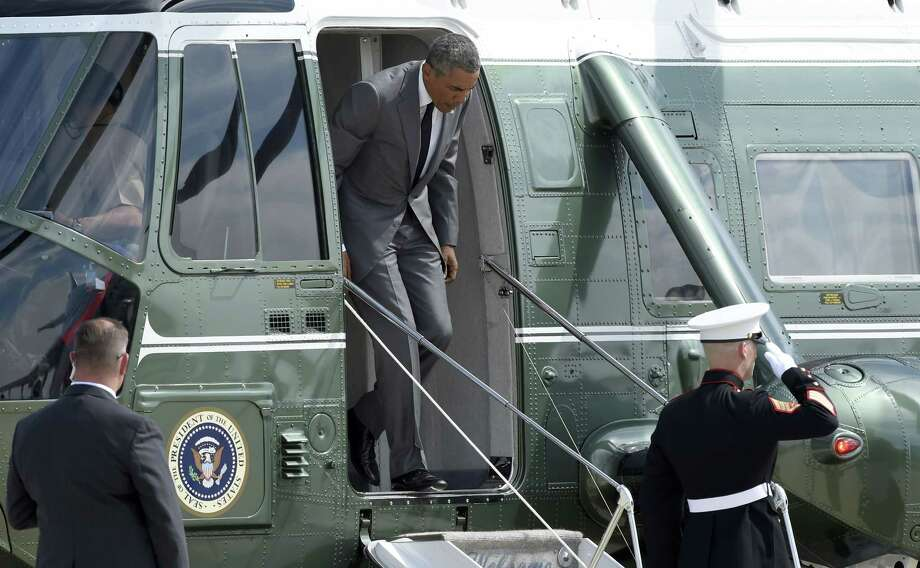 President Barack Obama walks off of Marine One at Air Force One at Andrews Air Force Base in Md. on Aug. 27, 2015 before boarding Air Force One en route to New Orleans for the 10th anniversary of Hurricane Katrina. Photo: AP Photo/Susan Walsh  / AP