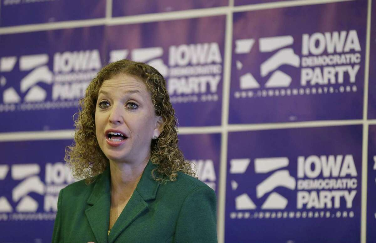 In this Jan. 24, 2015 photo, Democratic National Committee Chairwoman Rep. Debbie Wasserman Schultz, D-Fla., speaks during a news conference in Des Moines, Iowa. The Democratic National Committee barely has more cash than it does IOUs, and it is being outraised month after month by its Republican counterpart.
