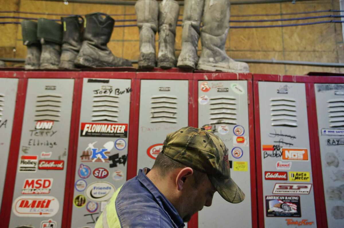 Coal miner David Turner, 35, walks out of the locker room after working a shift underground at the Perkins Branch Coal Mine in Cumberland, Ky.