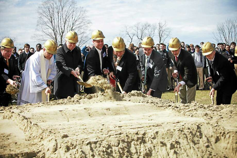 Alumni, architects and city officials joined together to break the ground for Xavier High's new athletic fields and fine arts building. Snapshot Photography - Special to the Press Photo: Journal Register Co. / Snapshot Photography