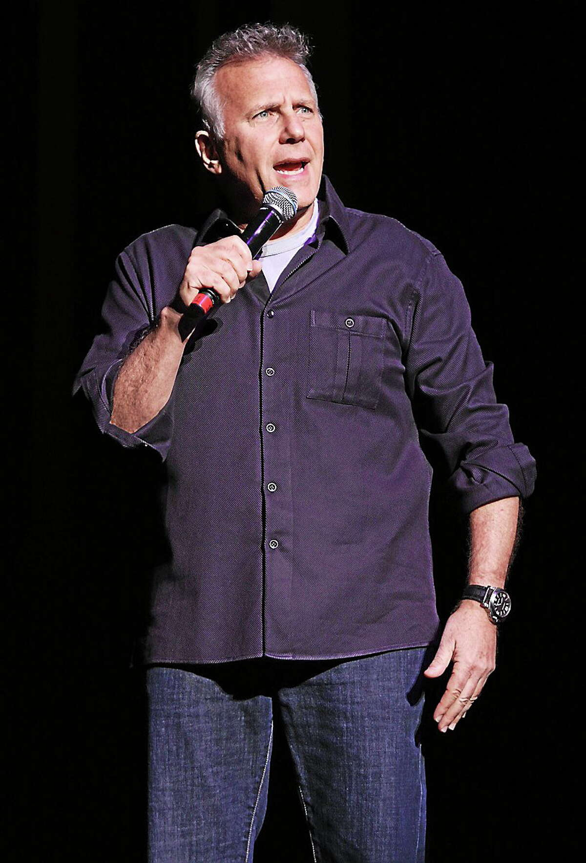 Comedian, actor, television personality, author and musician Paul Reiser is shown entertaining a sold out crowd during a