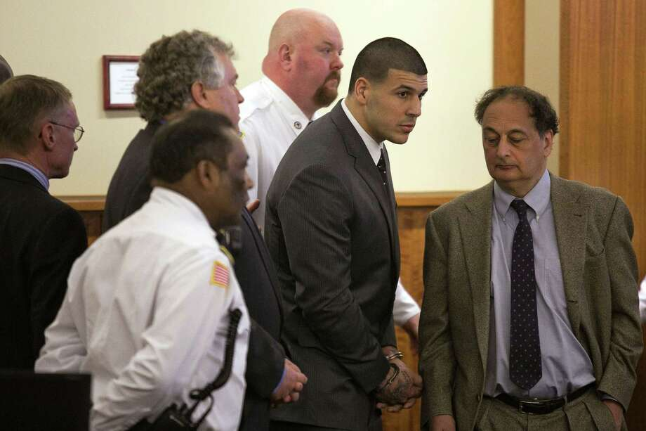 Former New England Patriot Aaron Hernandez stands up after he is sentenced to life in prison at his murder trial last Wednesday at the Bristol County Superior Court in Fall River, Mass. Photo: Dominick Reuter — The Associated Press  / POOL Reuters