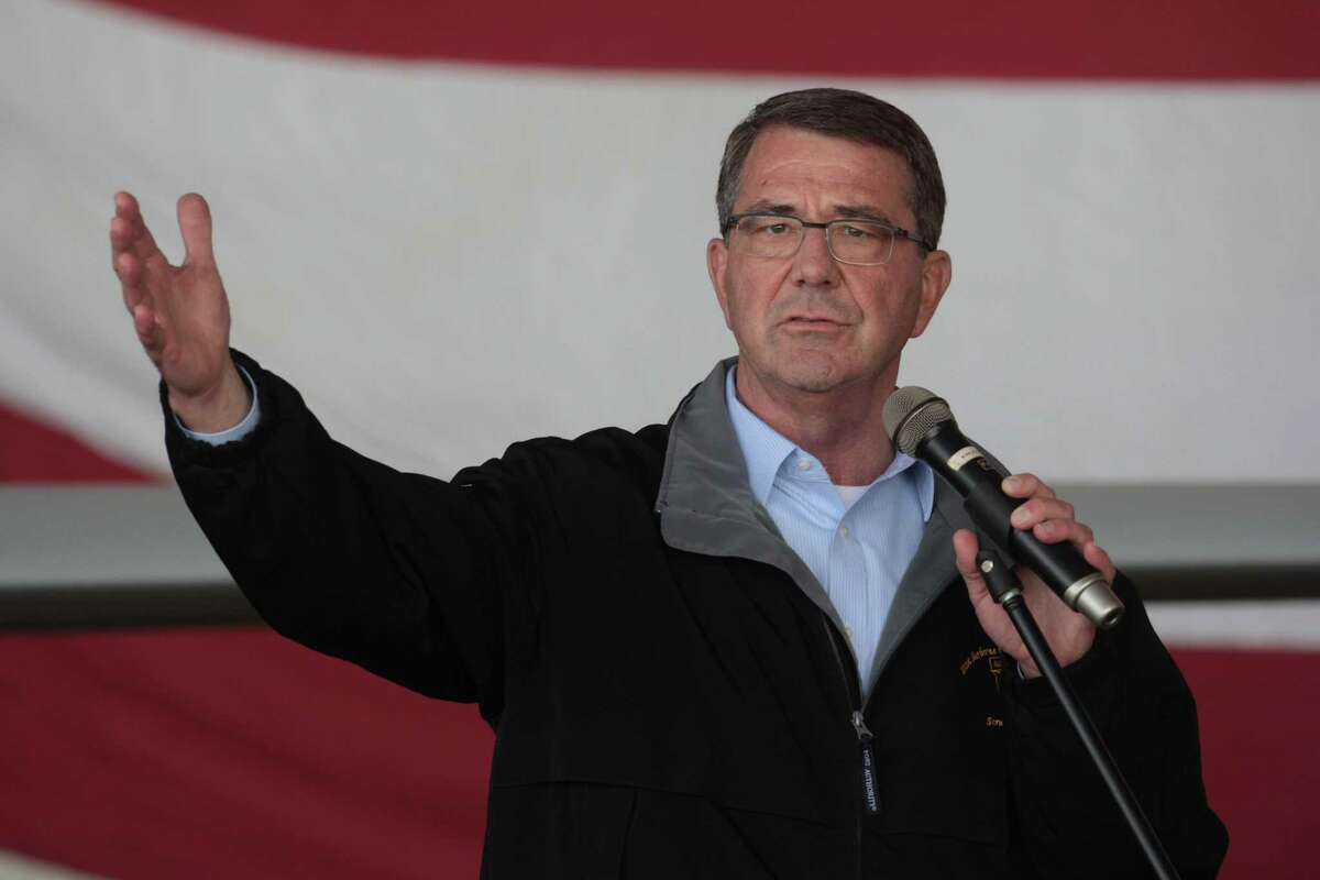 "U.S. Defense Secretary Ash Carter addresses the U.S. troops at the Incirlik Air Base near Adana, Turkey, Tuesday, Dec. 15, 2015. Carter said the U.S. wants Turkey to better control its border with Syria, which could help block the flow of foreign fighters to the Islamic State group, and to more forcefully join the U.S.-led coalition ""in the air and on the ground."""