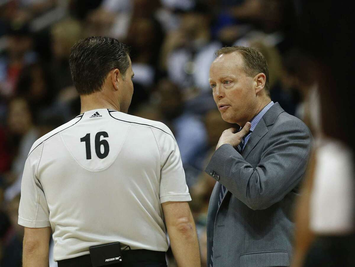 Hawks head coach Mike Budenholzer talks with referee David Guthrie during an April 13 game against the New York Knicks in Atlanta.
