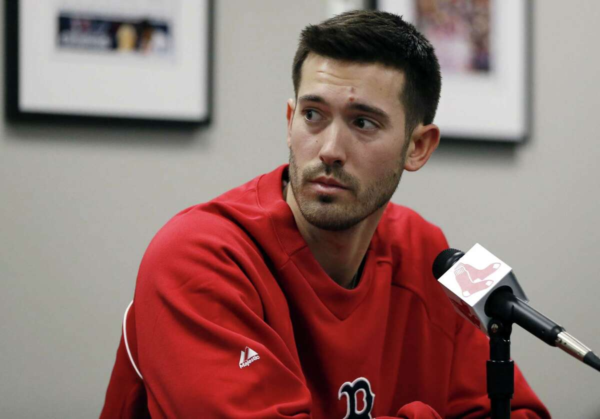 Newly acquired Red Sox pitcher Rick Porcello listens to a question during an introductory news conference at Fenway Park on Friday.