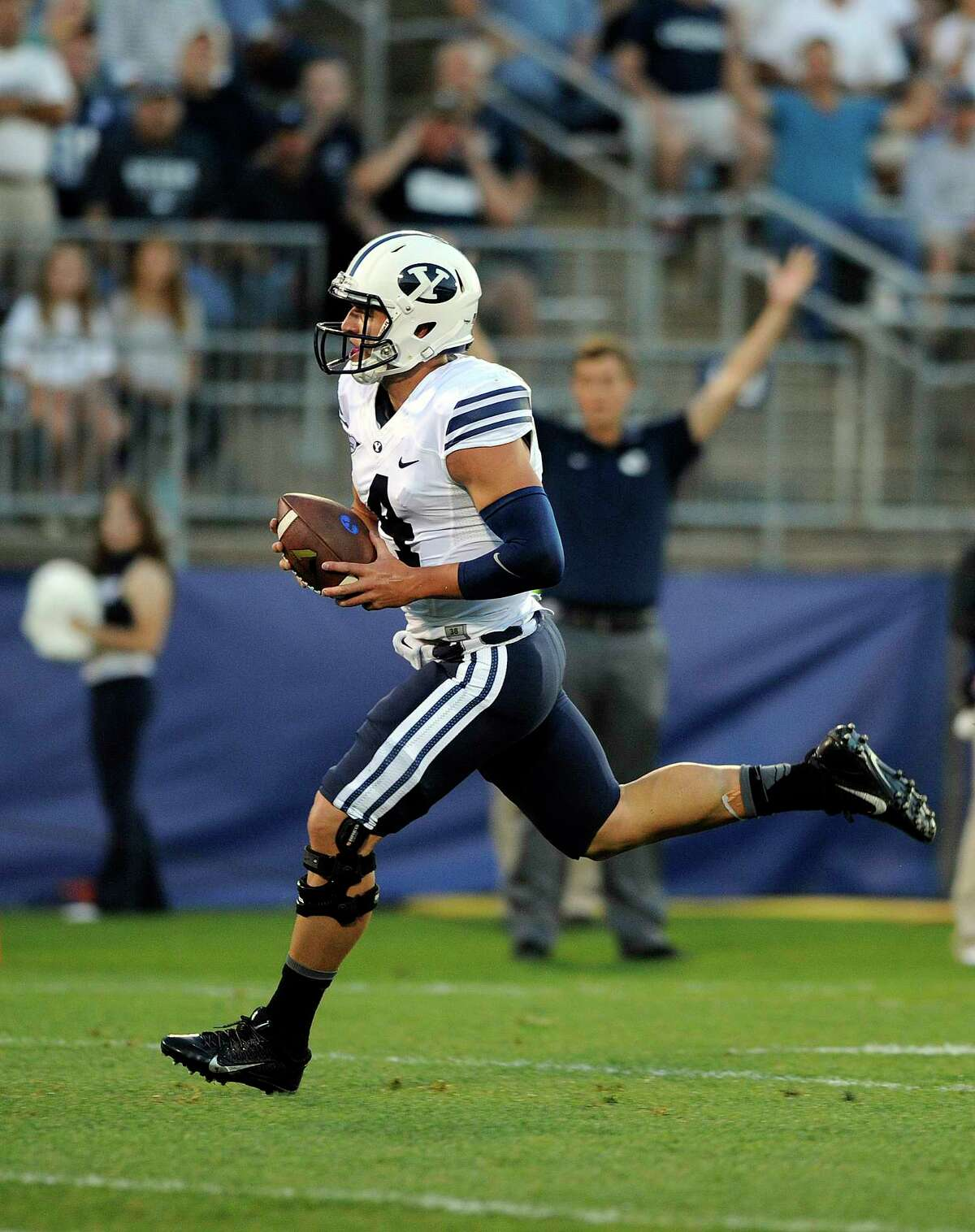 BYU quarterback Taysom Hill (4) runs for a touchdown during the Cougars' 35-10 win over UConn on Friday night at Rentschler Field in East Hartford.