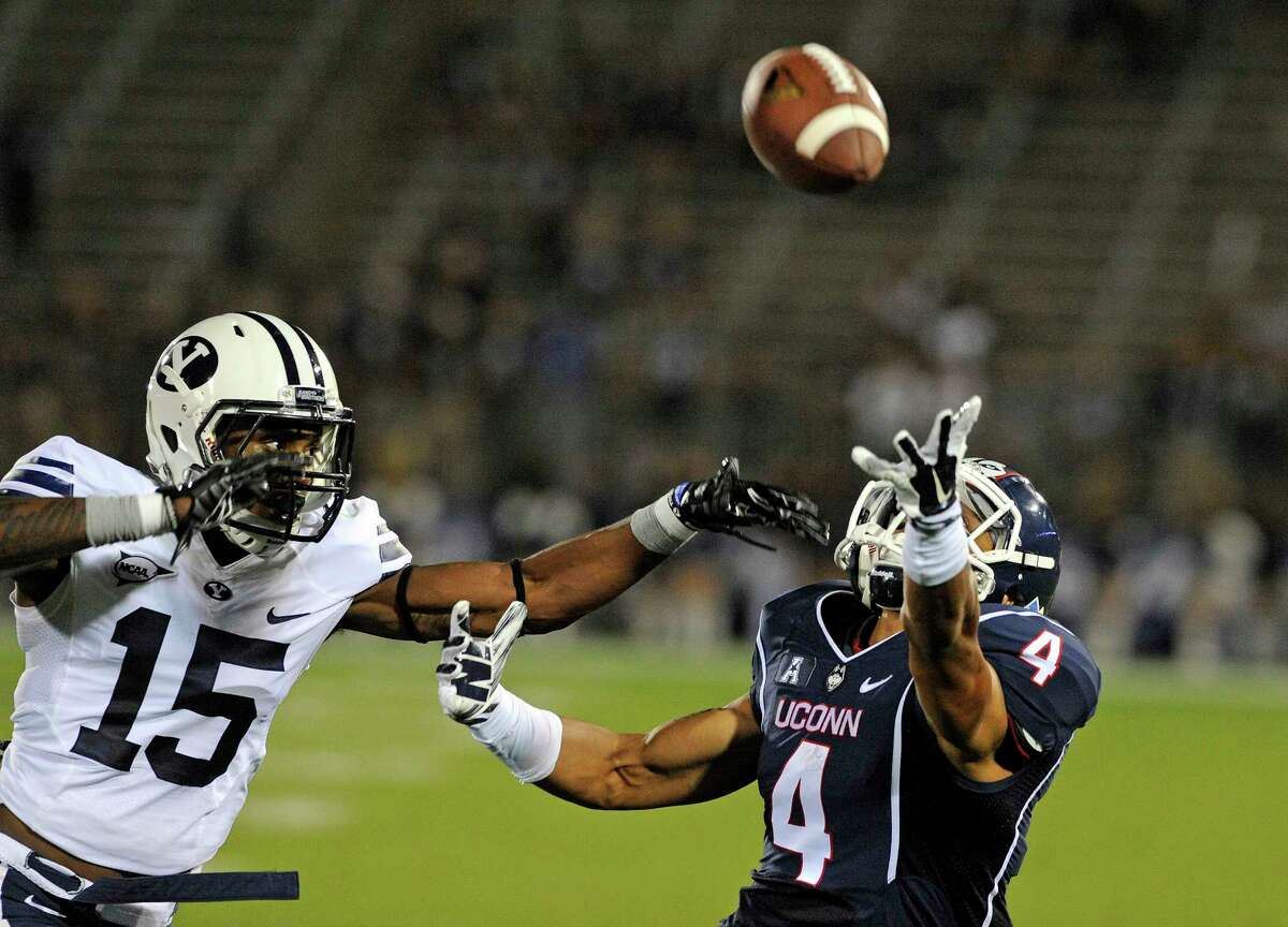 BYU cornerback Michael Davis (15) covers Connecticut wide receiver Deshon Foxx (4) during the second half of an NCAA college football game in East Hartford, Conn., Friday, Aug. 29, 2014. The pass was incomplete and BYU won the game 35-10. (AP Photo/Fred Beckham)
