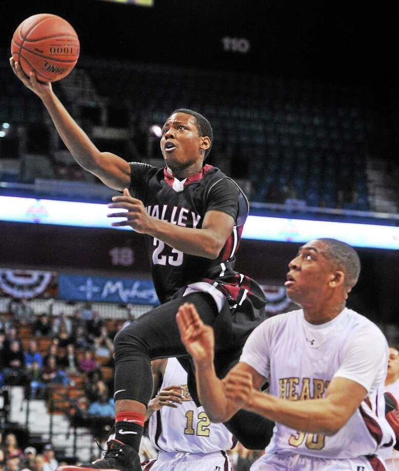Valley Regional's Chris Jean Pierre goes up for a layup during the Class S championship game against Sacred Heart last season. Photo: Mara Lavitt — New Haven Register File Photo