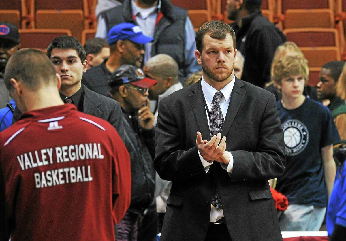 Valley Regional head coach Kevin Woods stands next to his team during the Class S championship game against Sacred Heart last season.