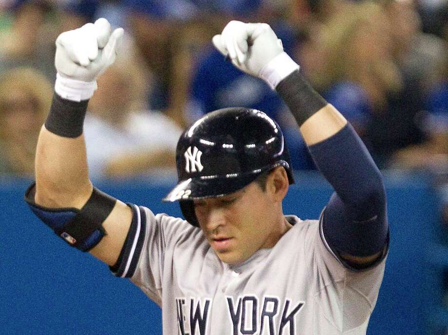 The Yankees' Jacoby Ellsbury reacts at home plate after hitting a two-run home run against the Blue Jays during the seventh inning of New York's 6-3 win on Friday in Toronto. Photo: Fred Thornhill — The Canadian Press  / The Canadian Press