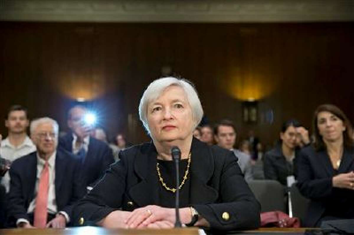 Janet Yellen, President Obama's nominee to succeed Ben Bernanke as Federal Reserve chairman, defends the Fed's stimulus policies as she testifies at her confirmation hearing before the Senate Banking Committee, on Capitol Hill in Washington, Thursday, Nov. 14, 2013. Yellen, 67, is expected to be confirmed by the Democratic-controlled Senate before Bernanke steps down in January. (AP Photo/J. Scott Applewhite)