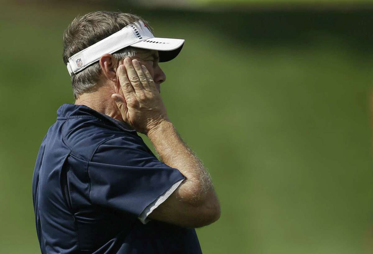 New England Patriots head coach Bill Belichick places his hand to his face while watching a team scrimmage Wednesday in Foxborough, Mass.