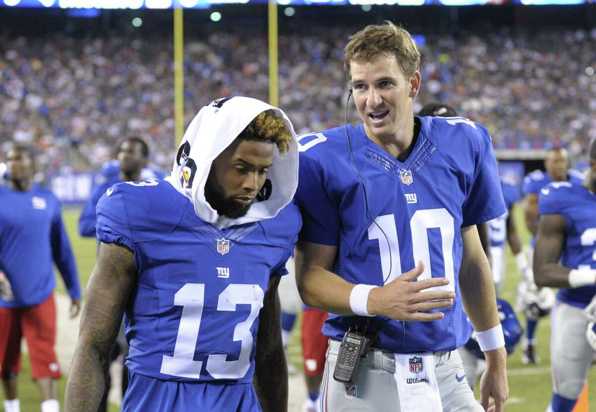 New York Giants quarterback Eli Manning (10) and Odell Beckham (13) talk while walking off the field after the first half of Saturday's preseason game in East Rutherford, N.J.