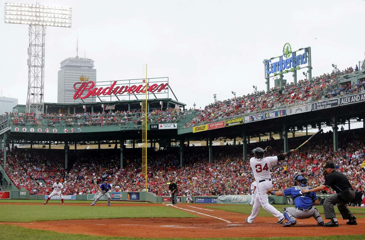 Red Sox DH David Ortiz swings against the Kansas City Royals on Sunday at Fenway Park in Boston.