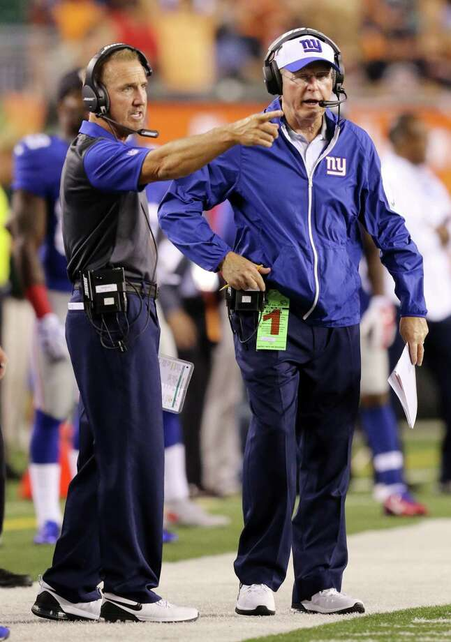 New York Giants defensive coordinator Steve Spagnuolo, left, and head coach Tom Coughlin are down to three safeties after cutting Brandon Meriweather. Photo: Gary Landers — The Associated Press File Photo  / FR171284 AP