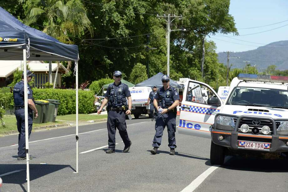 Police patrol near a house where eight children have been found dead in a Cairns suburb in far north Queensland, Australia, Friday Dec 19, 2014. Queensland state police said they were called to the home in the Cairns suburb of Manoora on Friday morning after receiving a report of a woman with serious injuries. When police got to the house, they found the bodies of the children inside, ranging in age from 18 months to 15 years.(AP Photo/Graeme Bint) Photo: AP / AP