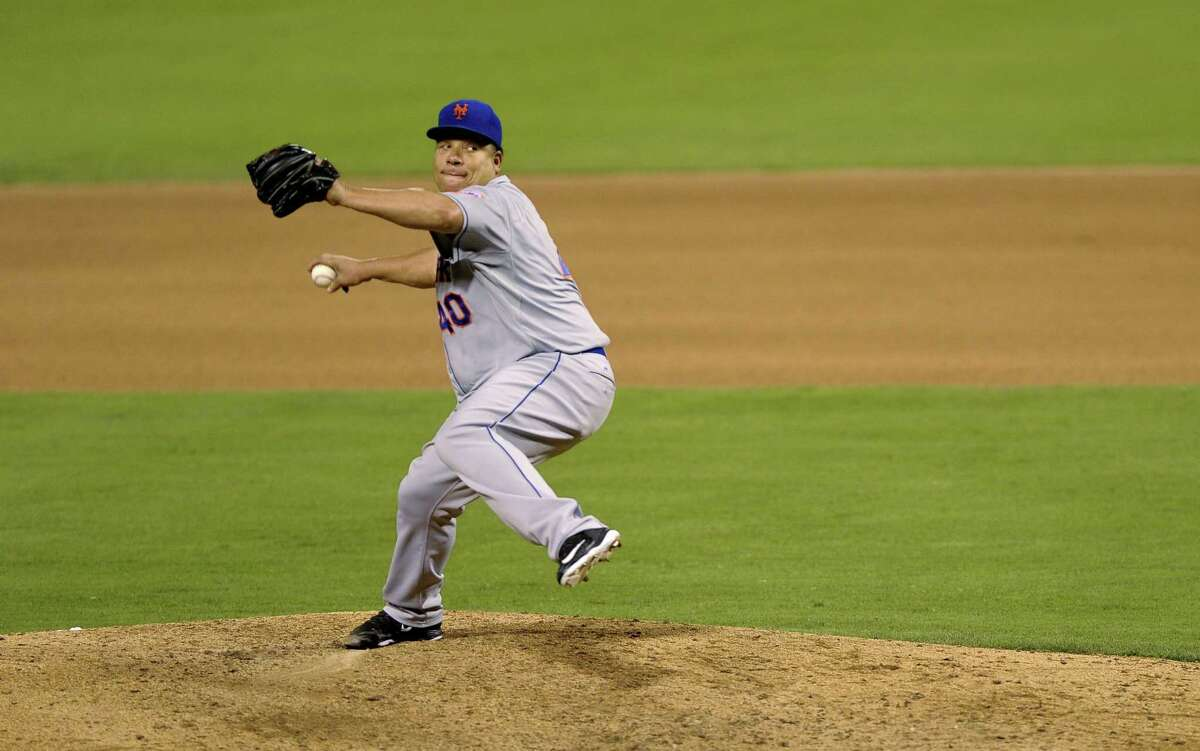 New York Mets starter Bartolo Colon pitches in the sixth inning of Wednesday's game against the Phillies in Philadelphia.