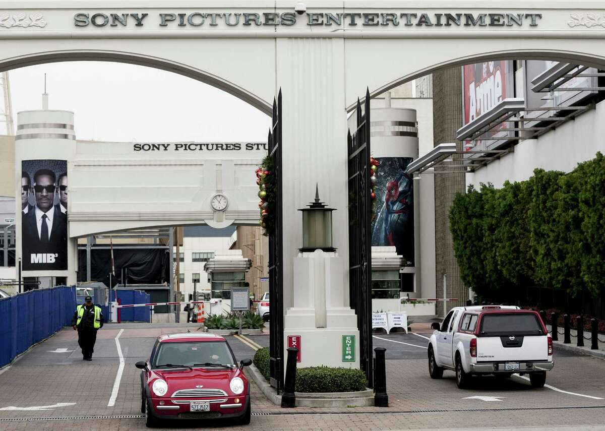 """Banners of blockbuster films as """"Men In Black,"""" """"Batman"""" and """"Annie"""" are displayed at the entrance of Sony Pictures Entertainment studio lot in Culver City, Calif. Faced with rising cybercrime like the attack on Sony Pictures Entertainment, companies worldwide are under pressure to tighten security but are hampered by cost and, for some, reluctance to believe they are in danger."""