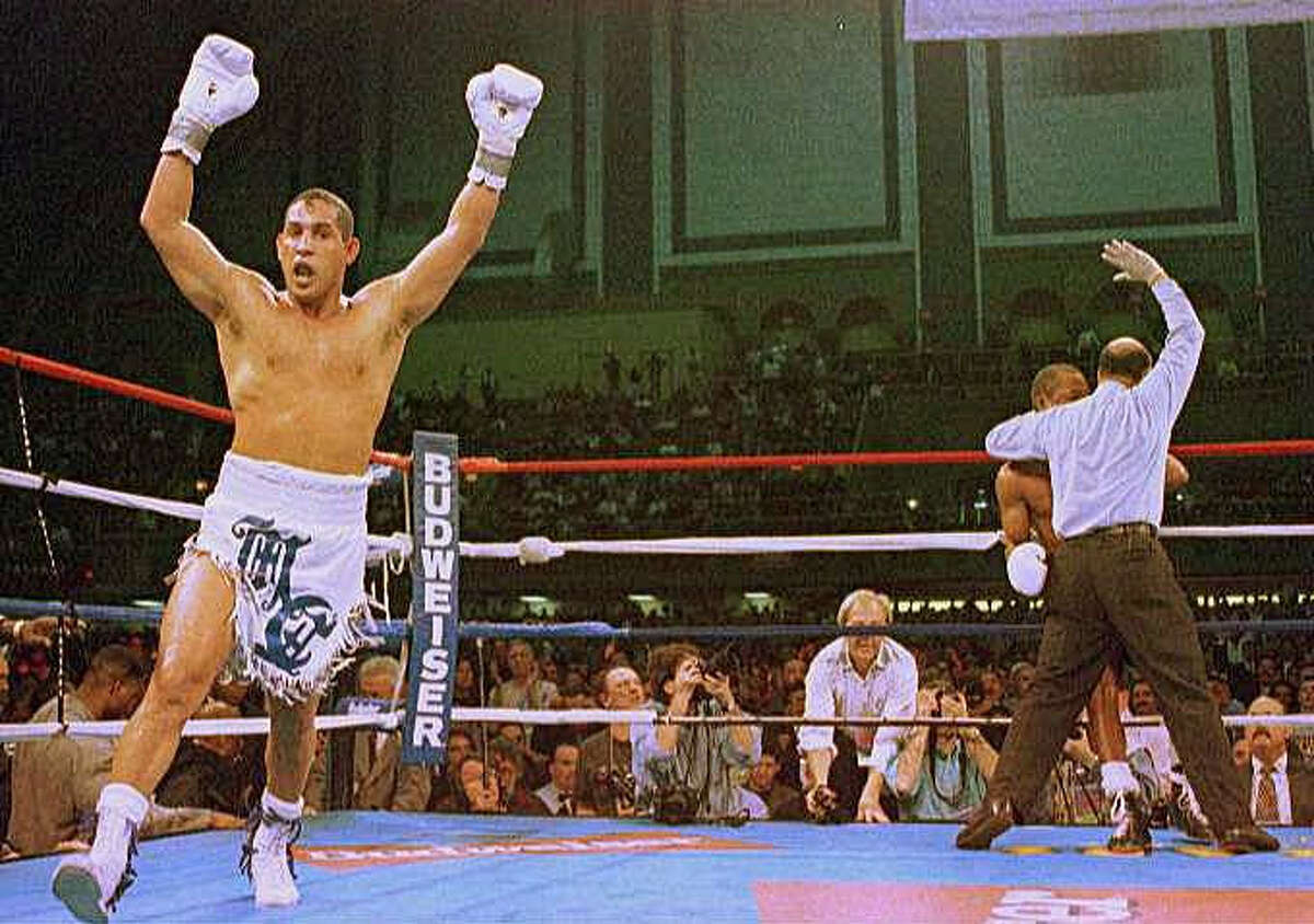 """In this March 1, 1997 file photo, Hector """"Macho"""" Camacho exults as referee Joe Cortez stops the fight with """"Sugar"""" Ray Leonard in the fifth round in Atlantic City, N.J. The Puerto Rican who grew up on the dangerous streets of Spanish Harlem and became world champion in three divisions is one of nine boxers who will enter the Hall of Fame of International Boxing."""