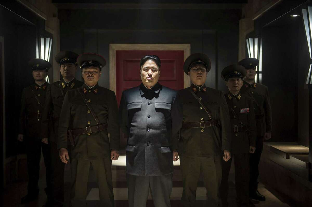 """Actor Randall Park, center, portrays North Korean leader Kim Jong Un in Columbia Pictures' """"The Interview."""""""