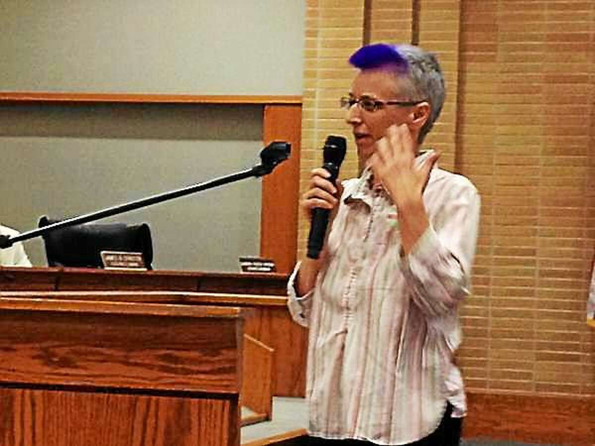 """A Middletown Common Council public session Tuesday evening involved much debate over the placing of artificial turf in city parks and school fields. Here, resident Alison Johnson says she supports the idea. """"One look at me and it's apparent not everything is organic in my life."""""""