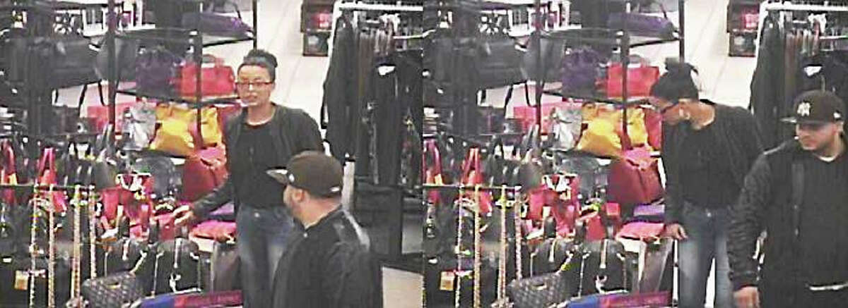 Police are looking to identify these two individuals who they say purchased over $1,200 worth of merchandise with stolen credit card information.