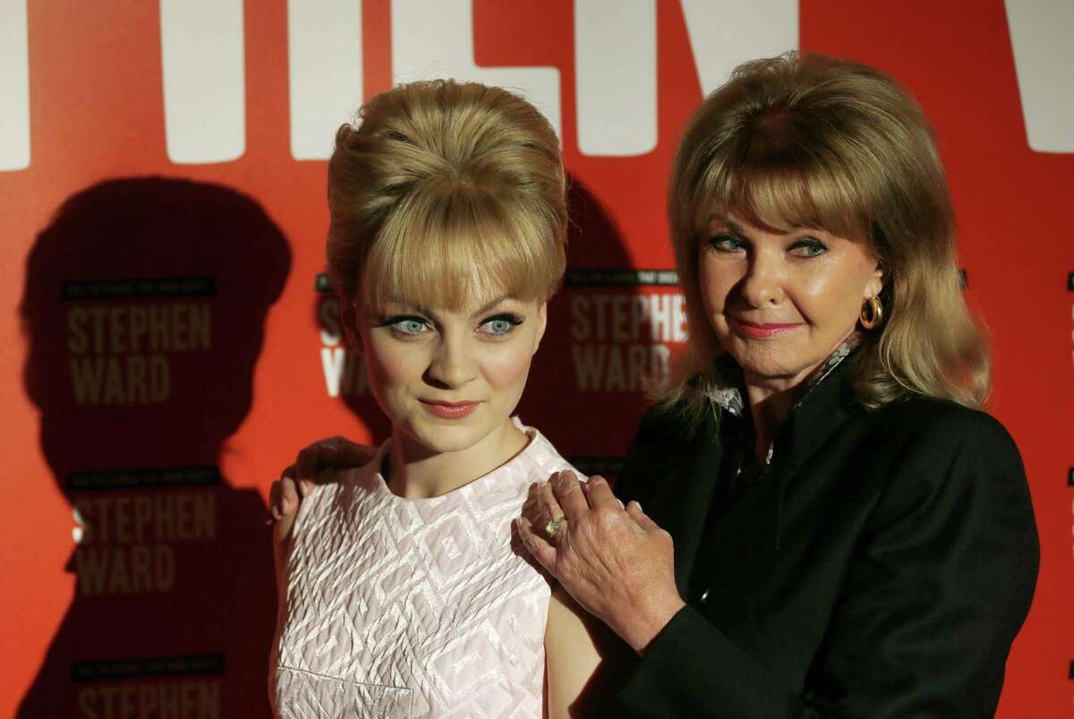 """FILE - In this Monday, Sept. 30, 2013 file photo, Mandy Rice Davies, former model and showgirl, right, poses with actress Charlotte Blackledge, who plays her in the new Andrew Lloyd Webber musical 'Stephen Ward', during the show launch photocall, in London. Mandy Rice-Davies, a key figure in Britain's biggest Cold War political scandal, the ìProfumo Affair,î has died. She was 70. Her PR firm said Friday Dec. 19, 2014, that Rice-Davies died Thursday evening """"after a short battle with cancer."""""""