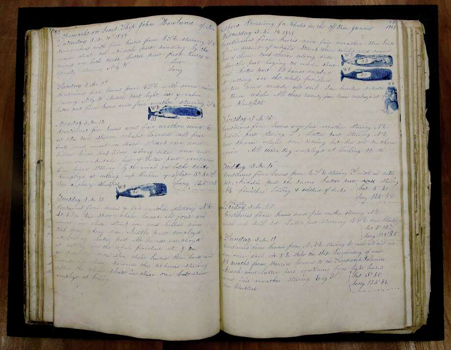 "In this Tuesday, Dec. 8, 2015, photo, a log book dated Nov. 2, 1847 through July 21, 1851 from the whaling vessel ""John Harland"" sits at the New Bedford Whaling Museum in New Bedford, Mass. The John Harland's log book if from a nearly four year-long sperm whale voyage off the coast of Peru. Maritime historians, climate scientists and ordinary citizens are coming together on a project to study 19th-century whaling ship logbooks to better understand modern-day climate change. The New Bedford Whaling Museum is transcribing and digitizing its logbooks as well as original data sources for this project, called ""Old Weather: Whaling."" Photo: AP Photo/Stephan Savoia  / AP"