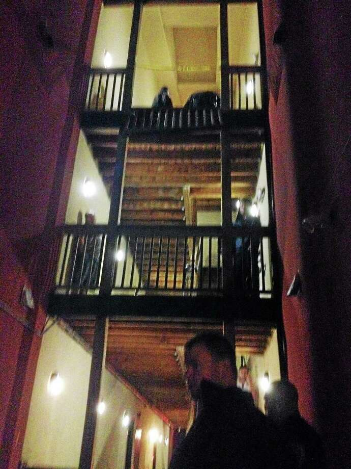 Courtesy photo A witness took this photo following an incident in which police say a teen fell from a third-story window at the Wharfside Commons apartment building earlier this week in Middletown. Photo: Journal Register Co.