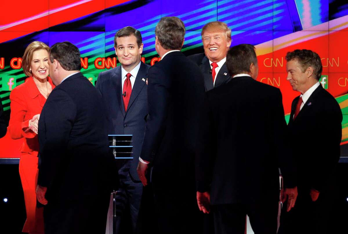 Republican presidential candidates, from left, Carly Fiorina, Chris Christie, Ted Cruz, Jeb Bush, Donald Trump, John Kasich and Rand Paul talk together following the CNN Republican presidential debate at the Venetian Hotel & Casino on Dec. 15, 2015 in Las Vegas.