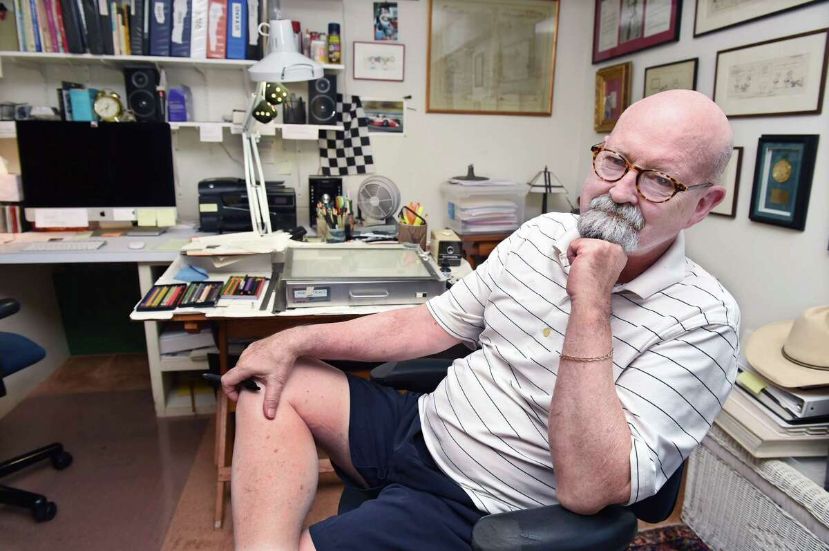 Bob Englehart, an editorial cartoonist at The Hartford Courant, is shown in his studio at his Middletown home he shares with his wife, Pat McGrath.