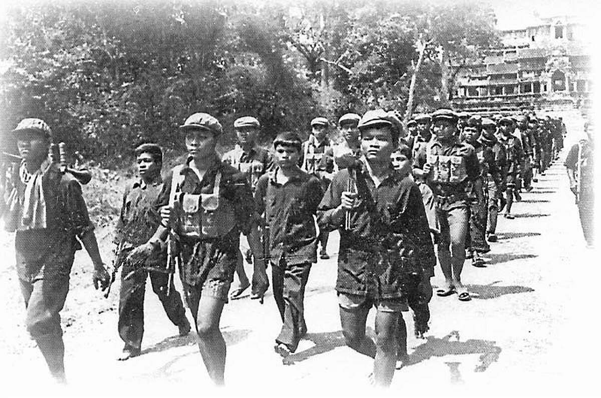 A Cambodian army of children is shown during the brutal Khmer Rouge regime.
