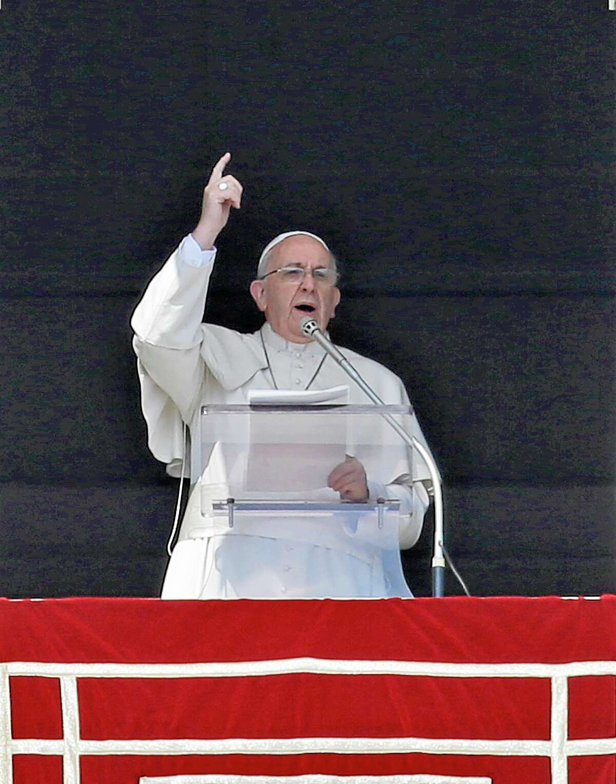 Pope Francis delivers his message on the occasion of the Angelus noon prayer in St. Peter's Square, at the Vatican, Sunday, March 16, 2014. (AP Photo/Gregorio Borgia)