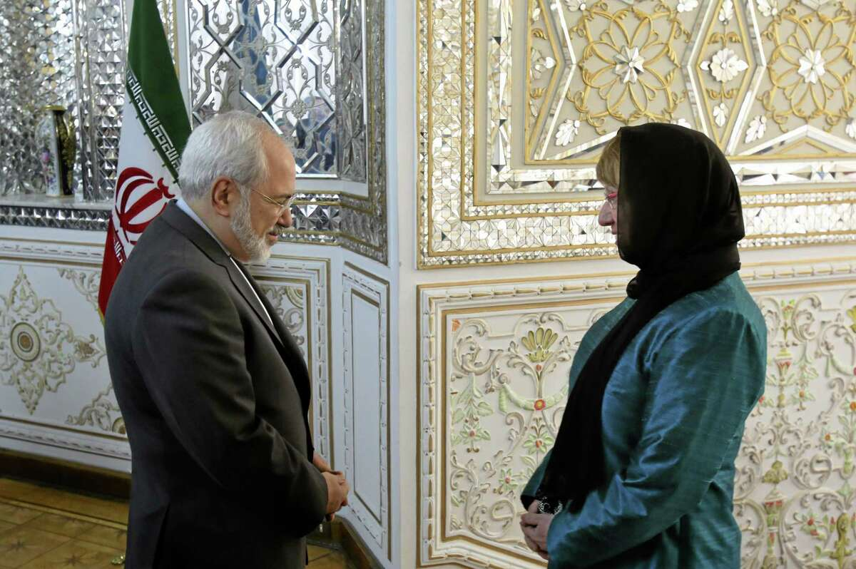 Iranian Foreign Minister Mohammad Javad Zarif, left, welcomes European Union's foreign policy chief Catherine Ashton for their meeting, in Tehran, Iran, Sunday, March 9, 2014. Ashton is saying there is no guarantee for a successful final nuclear deal with Iran.