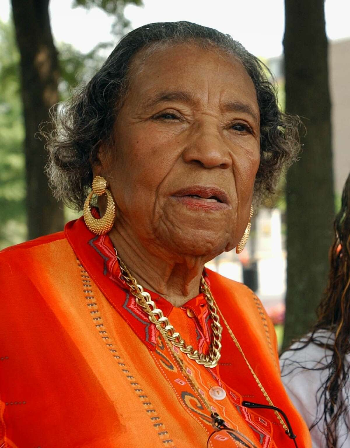 """In this Aug. 26, 2003, file photo, Amelia Boynton, Robinson appears at an American Civil Rights Education Services tour at the Martin Luther King, Jr. National Historic Site in Atlanta. Boynton Robinson, a civil rights activist who nearly died while helping lead the Selma march on """"Bloody Sunday,"""" championed voting rights for blacks, and was the first black woman to run for Congress in Alabama, died Wednesday, Aug. 26, 2015. She was 104. Boynton Robinson was hospitalized in July after having a major stroke and turned 104 on Aug. 18."""