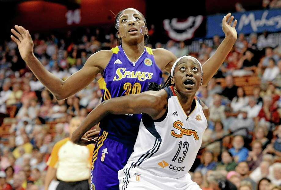 The Connecticut Sun's Chiney Ogwumike, right, and the Los Angeles Sparks' Nneka Ogwumike, became the first pair of siblings to be No. 1 overall WNBA draft choices earlier this year. Chiney has now joined Nneka to become the only pair of sisters to each be named the WNBA Rookie of the Year. Photo: Jessica Hill — The Associated Press File Photo  / FR125654 AP