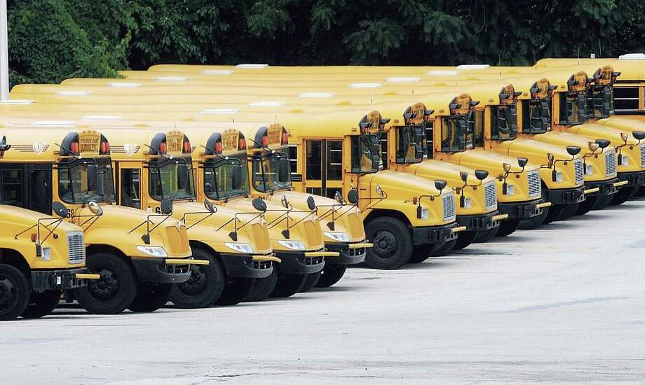 Upper Merion buses parked in the school districts lot on Henderson Road in Upper Merion July 18, 2011. Photo by Gene Walsh / Times Herald Staff
