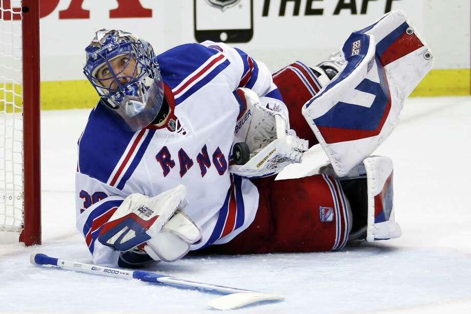 Rangers goalie Henrik Lundqvist sprawls to make a save during the second period on Monday. Photo: Gene J. Puskar — The Associated Press  / AP