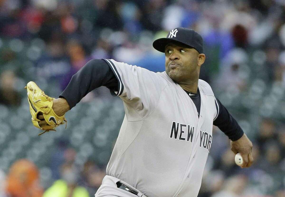 Yankees starting pitcher CC Sabathia throws during the first inning Monday.