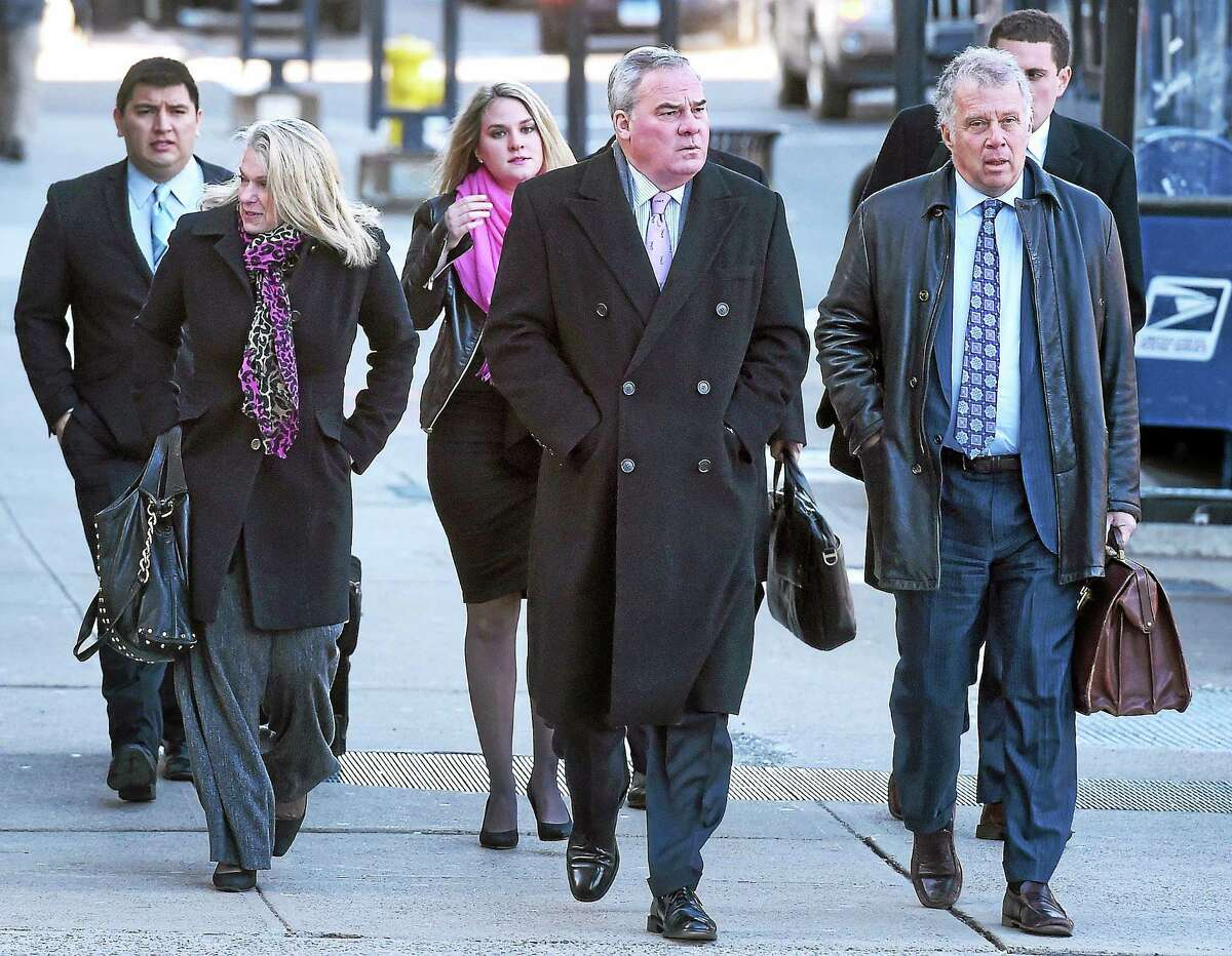 Former Connecticut Governor John Rowland (center) walks to Federal Court in New Haven for sentencing with his wife, Patty (left), on 3/18/2015.