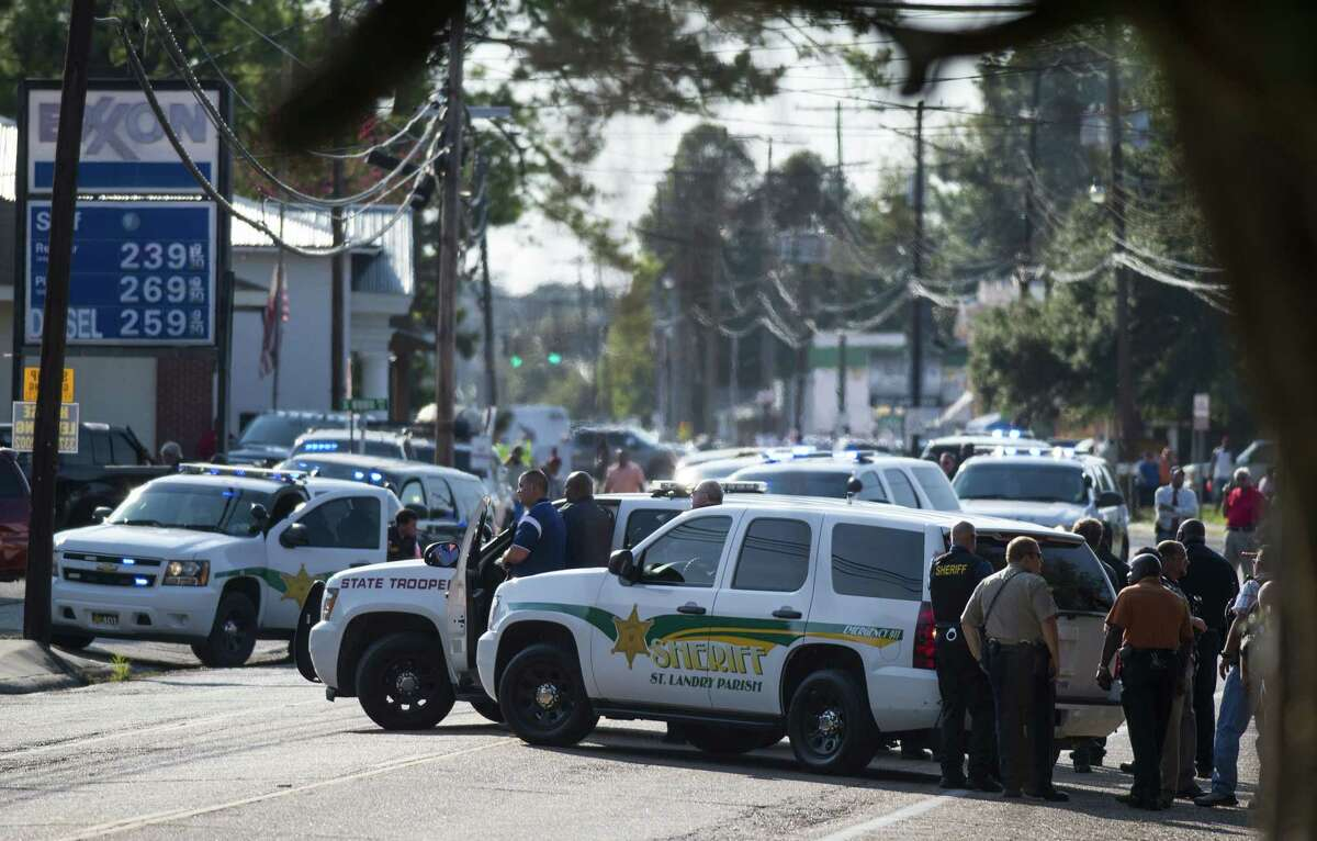 Police gather at the scene of a shooting in Sunset, La., Wednesday, Aug. 26, 2015.