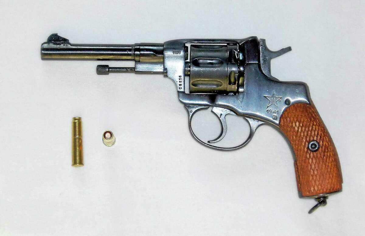 A game of Russian roulette is set up with a Nagant revolver in this Wikipedia photo illustration.