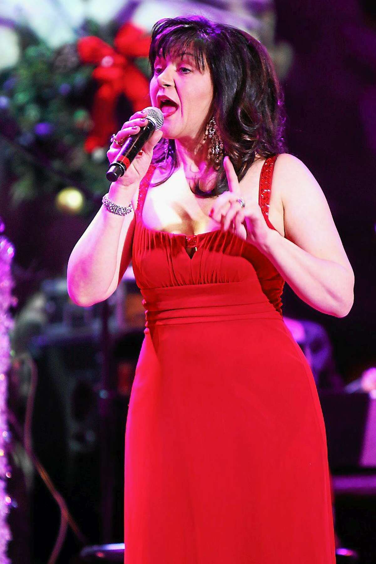 Photo by John Atashian Singer Michelle Berting Brett is shown entertaining a capacity crowd of fans with holiday hits and songs of The Carpenters during her performance at the Mohegan Sun Casino on Dec. 6. Currently based in Connecticut, Michelle appears regularly with the Heartbeat Jazz Band. Other recent performance include singing background vocals for Ronnie Spector (The Ronettes), singing with Marshall Lytle (Bill Haleyís Comet), and guesting with Matt ìGuitar Murphy (The Blues Brothers) opening for Little Richard at BB Kingís Club in NYC. Michelle regularly stars in ìWeíve Only Just Begun: Carpenters Rememberedî. To learn more about this rising star you can visit her website at www.michellebertingbrett.com
