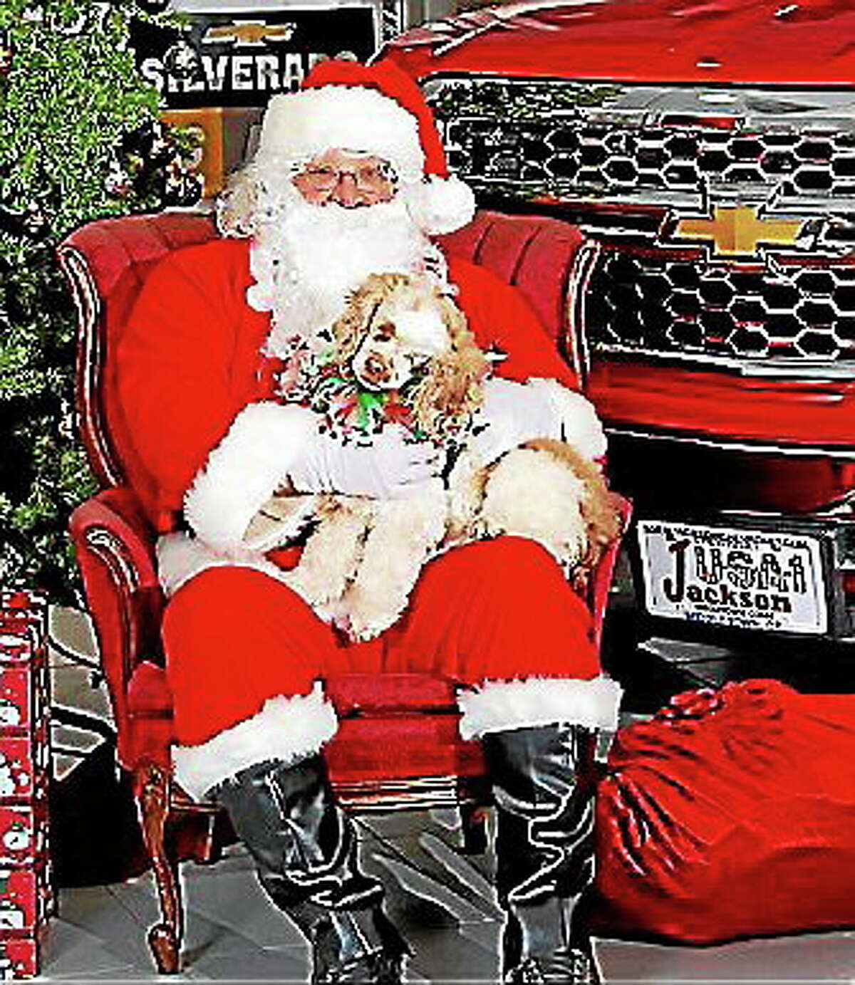 Submitted photo Helen, a dog that had been up for adoption, sits with Santa during a previous Jackson Chevrolet pet adoption event.