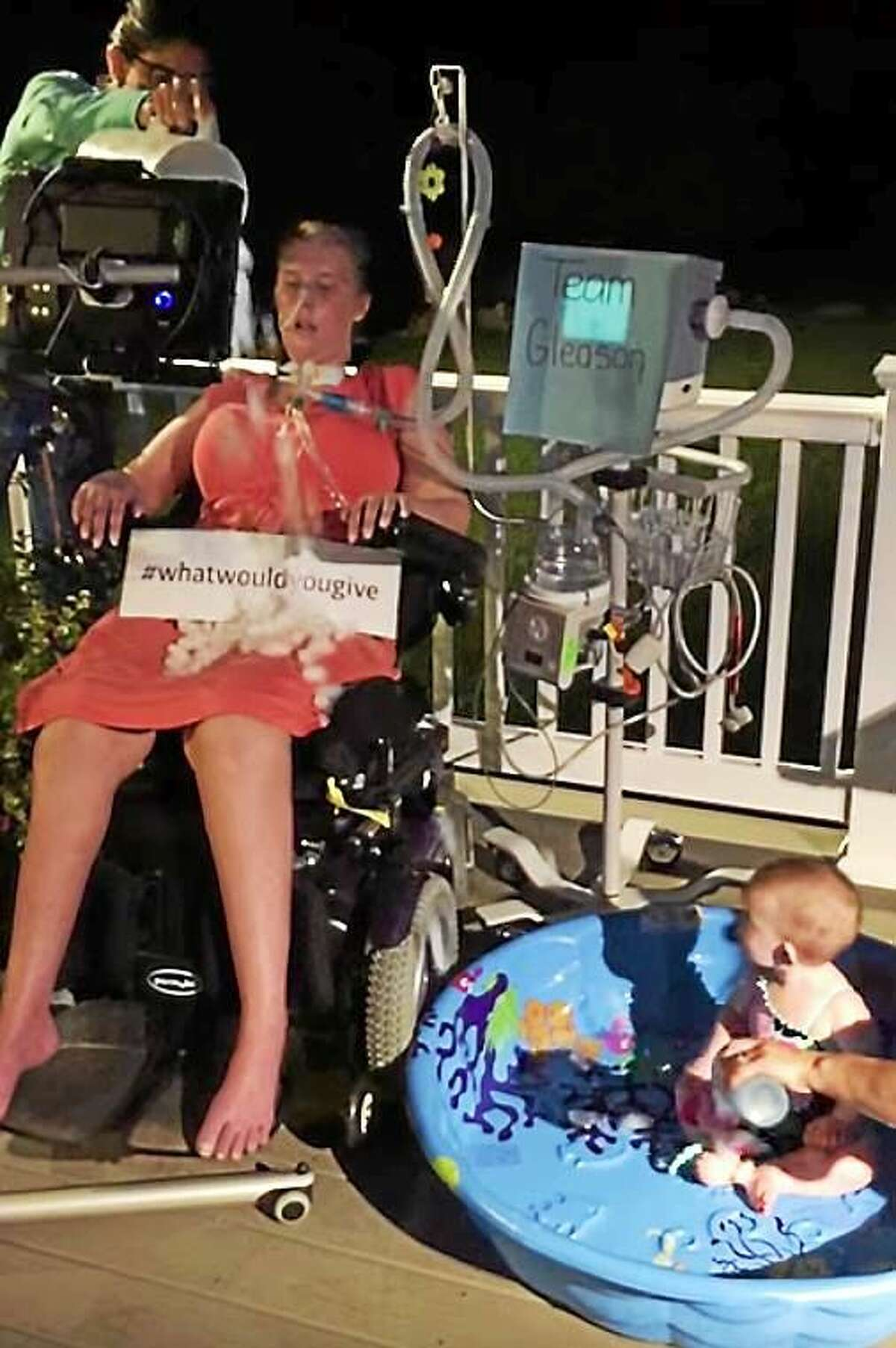 Amanda Bernier and her daughter, Arabella, as she does the ALS Ice Bucket Challenge for the second time in 2015 in this screenshot taken from a YouTube video posted on her Facebook page Amanda's Angels.