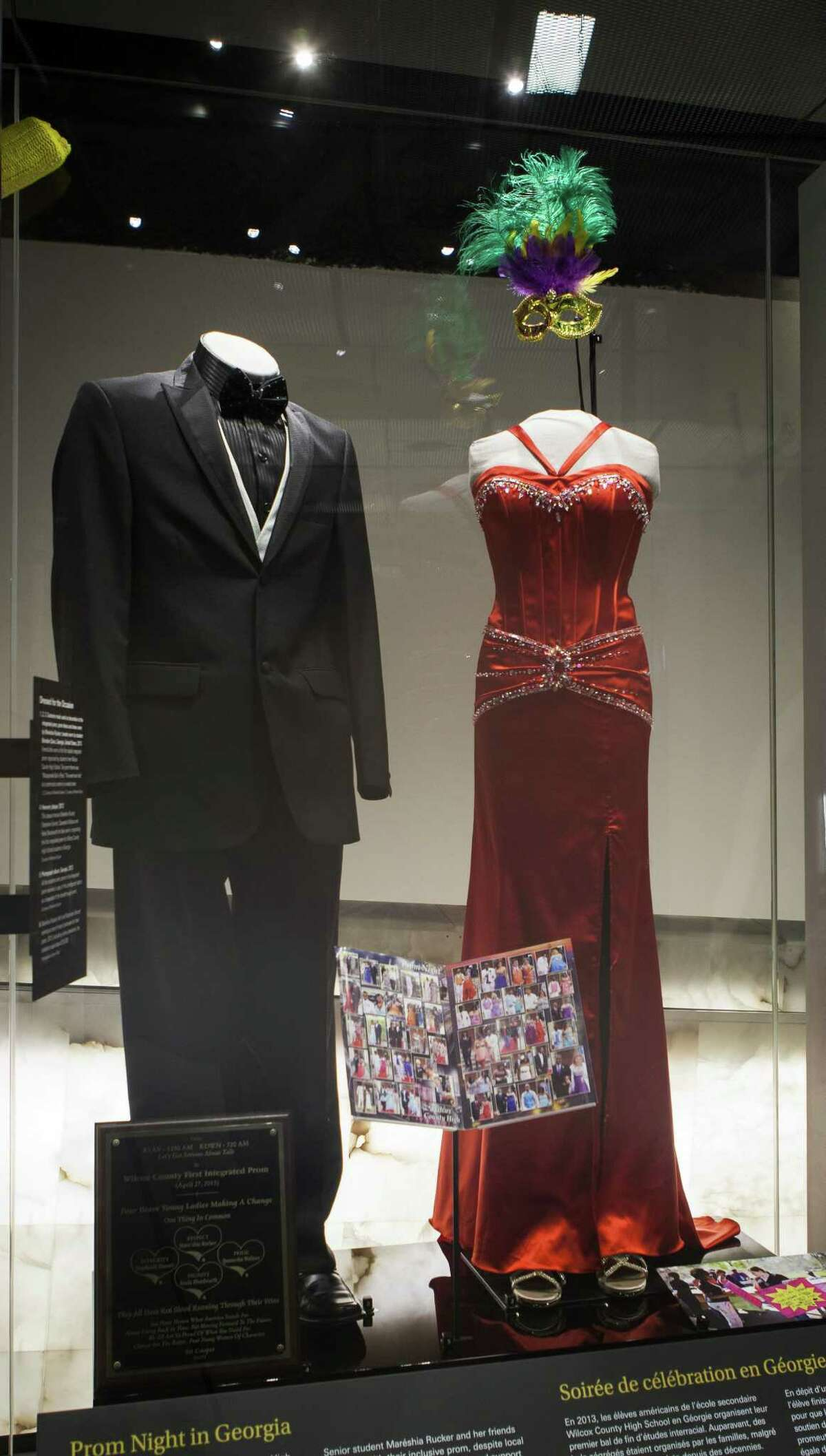 This 2014 photo provided by the Canadian Museum for Human Rights in Winnipeg, Canada, shows outfits worn to an interracial prom organized by Mareshia Rucker and other students from Wilcox County High School in Rochelle, Ga. Local families had previously organized separate proms for black and white students.