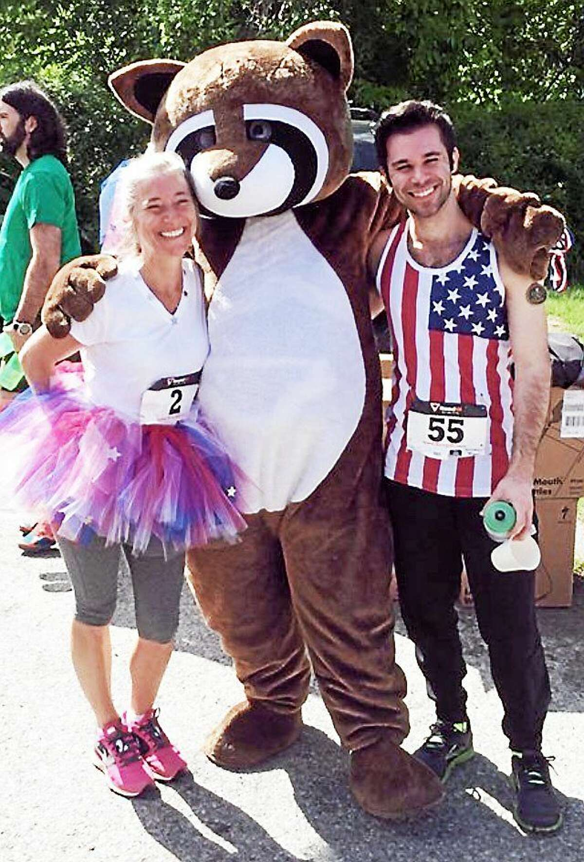 Middletown runner Julie Cesare, left, wears her trademark tutu to one of the many races she's taken part in since suffering a traumatic brain injury. She is pictured with her son, Travis Rock, also a survivor of a traumatic head injury.